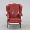A leather wingback chair later part of the 20th century.