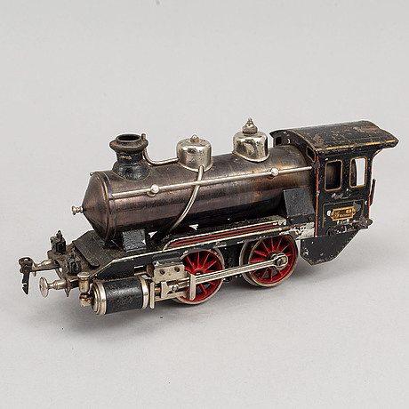 A steam engine wirt tender and wagons, early 20th century.