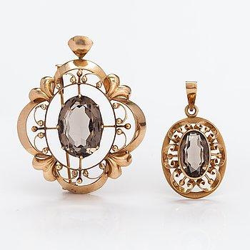 Two 14K gold pendant with smoaky quartzes. Helsinki 1970 and 1979.