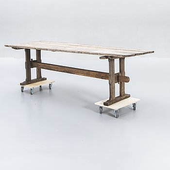 A wooden table around 1900.