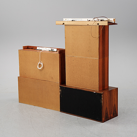 "Poul cadovius. a shelf system veneered with palisander, ""royal system"", denmark."