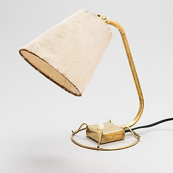 A mid-20th century table lamp /wall light for Idman.