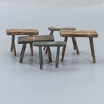 A set of five wooden stools around 1900.