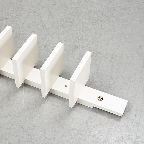 A 'pilaster' shelf by john kandell for källemo, designed 1988.