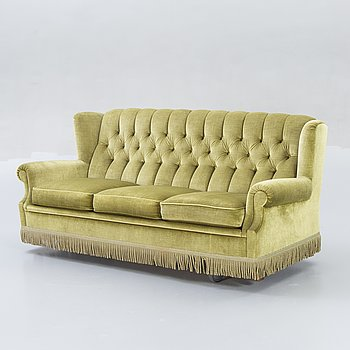 A late 20th century velvet sofa.