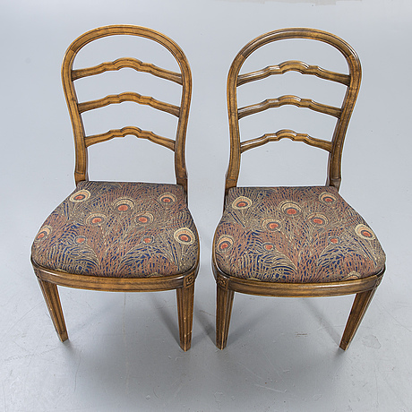 A pair of nk 1922 chairs.