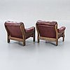 A pair of 1970s leather easy chairs.
