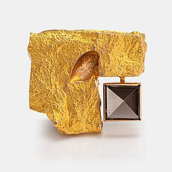 "Björn Weckström, A 14K gold brooch ""Crystal and cut"" with a smoaky quartz. Lapponia 1967."