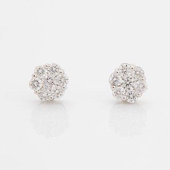 Brilliant-cut diamond earrings.