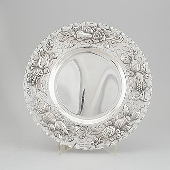 A Baroque style silver charger, maker's mark Eric Råström, CG Råström, Stockholm, 1977.