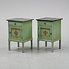 A pair of stone top bedside tables, irst half of the 20th century.