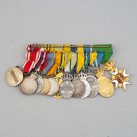 A medalbar with 13 decorations among others order of the vasa knight's cross in gold.