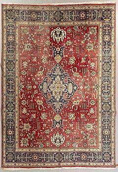 A semiantique Tabriz carpet ca 370x296 cm.