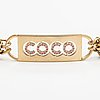 "Chanel, a gold coloured metal chain belt with pink stones. marked ""chanel 02 cc p made in italy""."