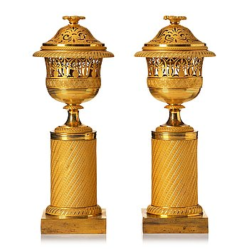 117. A pair of French Empire candlesticks, early 19th century.