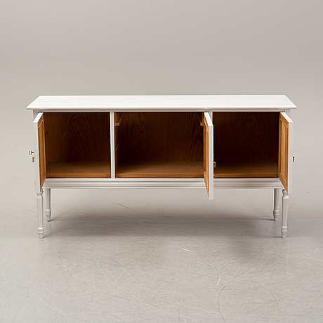 A painted gustavian style sideboard, second half of the 20th century.