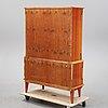 A mahogany veneered cabinet, mid 20th century.