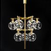 A brass chandelier with nine glass globes by hans-agne jakobsson, markaryd.
