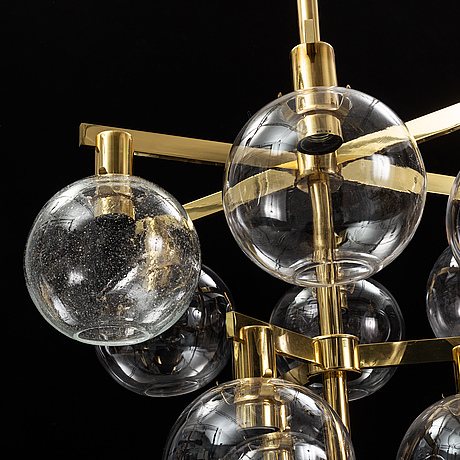 A brass chandelier with glass globes by hans agne jakobsson, markaryd.