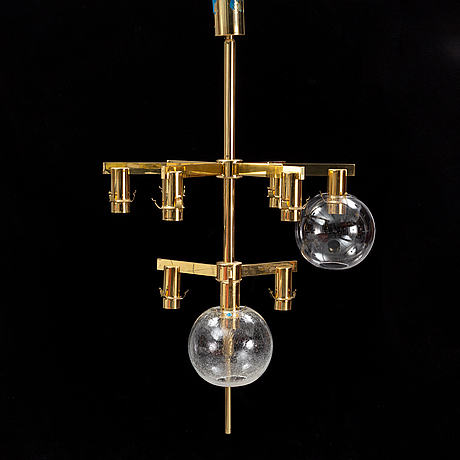 A brass chandelier with two glass globes by hans-agne jacobsson, markaryd.