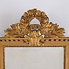 A gustavian style gilded and bronzed scone, first half of 20th century.