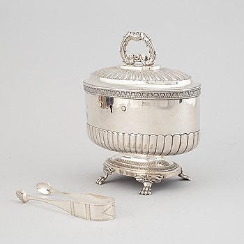A silver sugar casket, Anders Lundqvist, Stockholm 1832 and a silver sugar tong by Petter Norlin, Malmö, 1811.