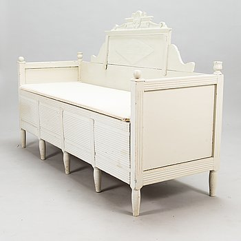 A mid-19th century pull-out sofa in Gustavian style from Hälsingland, Sweden.