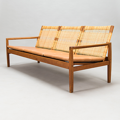 Hans olsen, a teak and rattan sofa for juul kristensen, denmark, late 1950s.