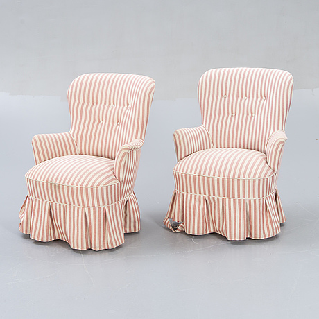 A pair of modern easy chairs.