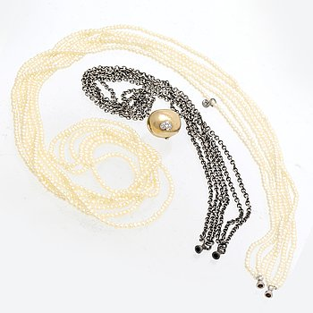 Ole Lynggaard 2 necklaces, silver and seedpearls, clasp 14 K gold, lengths approx 45 cm and 90 cm.