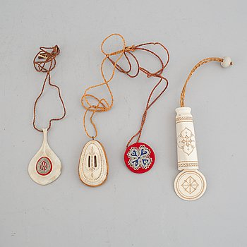 Four Sami pendants, reindeer horn, birch and embroidery with silver thread, one signed TF for Torsten Fankki.