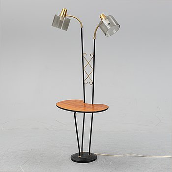 A mid 20th Century floor light with table.