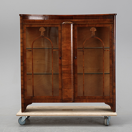 A display cabinet, 1920's.