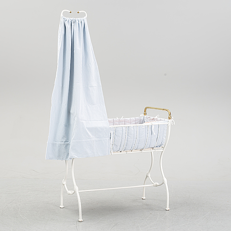 A children's or toddler's crib, the first half of the 20th century.