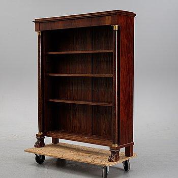 An empire style mahogany book case, early 20th Century.