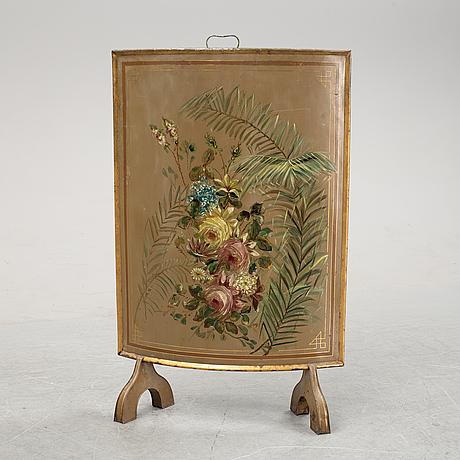 A 19th century fire screen.