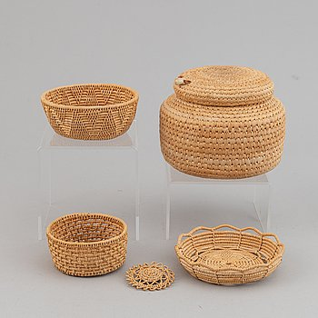 Four Sami handicraft rootwork baskets, one signed Margit Kitok-Åström, three baskets and a brooch.