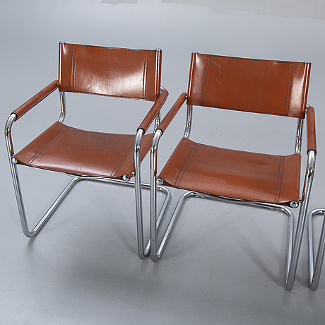 A swet of four italien leather armchairs later part of the 20th century.
