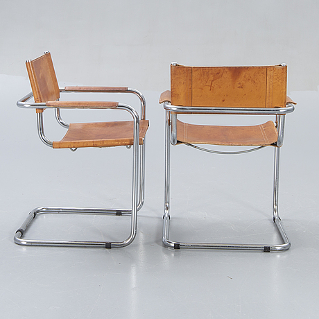 A set of two italien leather armchairs later part of the 20th century.
