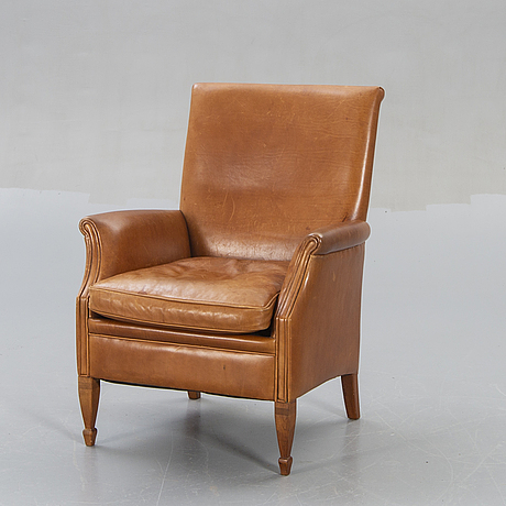 A late 20th century leather easy chair.