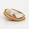 Carved sea shell brooch, 18k gold.