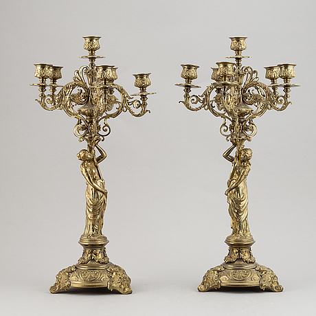 A pair of late 19th century brass candelabra for six candles.