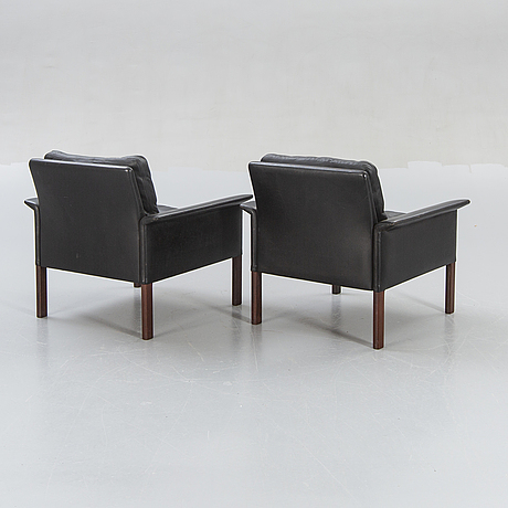 A pair of 1960s leather easy chairs.