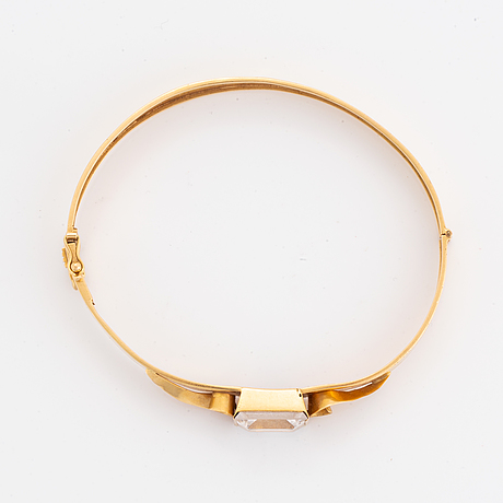 18k gold bangle and white synthetic stones.