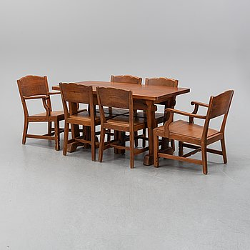 A mid 20th Century pine seven-piece dining suite.