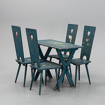 A set of four chairs and a table, the first half of the 20th century.