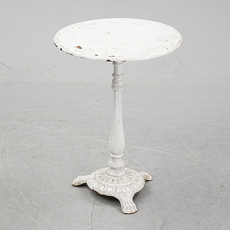 A cast iron garden table, early 20th century.
