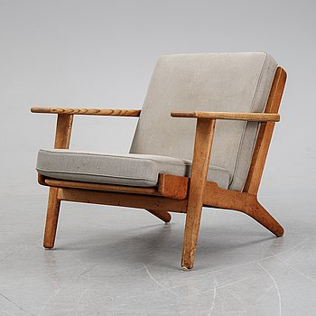 "Hans J Wegner, an oak ""'GE-290"" easy chair from Getama, Denmark."