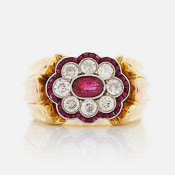 A WA Bolin ring in 18K gold set with rubies and round brilliant-cut diamonds.