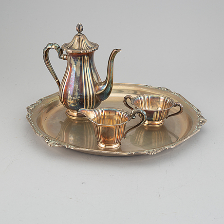 A silver coffee set and a tray, maker's mark carl hoff, helsingborg, sweden 1934 and 1933,